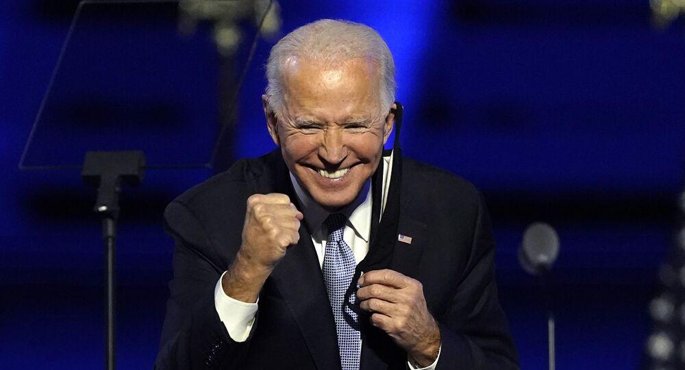 resident-elect Joe Biden gestures to supporters Saturday, Nov. 7, 2020, in Wilmington, Del
