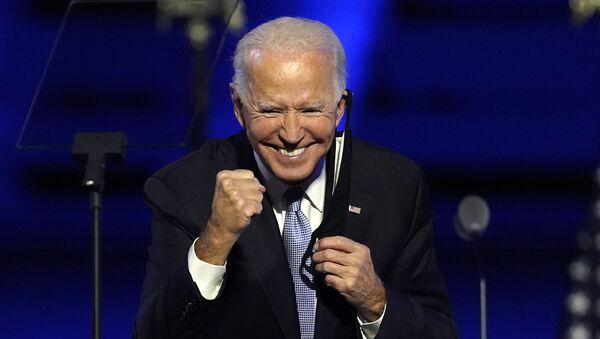 President-elect Joe Biden gestures to supporters Saturday, 7 November 2020, in Wilmington, Delaware. - Sputnik International