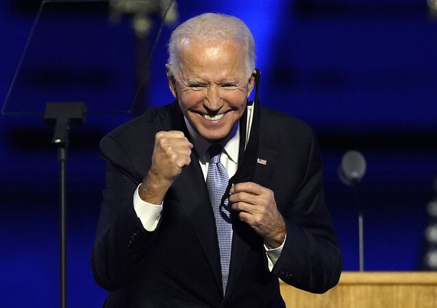 President-elect Joe Biden gestures to supporters Saturday, 7 November 2020, in Wilmington, Delaware.