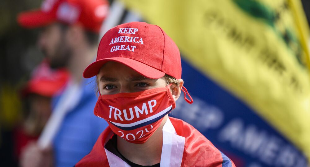 Supporters of US President Donald Trump look on in front of the White House as they gather near counter-protesters in Washington, DC on 13 November 2020.
