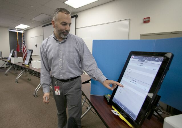 In this Sept. 16, 2019 file photo, Scott Tucker demonstrates the Dominion Voting system Georgia will use in Atlanta.