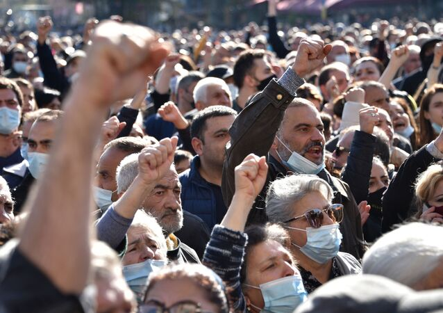 People protest during a rally against the country's agreement to end fighting with Azerbaijan over the disputed Nagorno-Karabakh region outside the government headquarters in Yerevan on November 11, 2020.