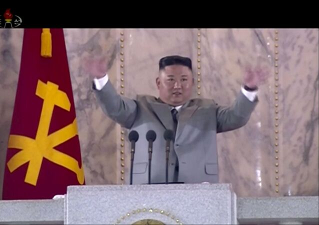 In this image made from video broadcast by North Korea's KRT on Saturday, 10 October 2020, North Korean leader Kim Jong-un waves during a ceremony to celebrate the 75th anniversary of the country's ruling party in Pyongyang.