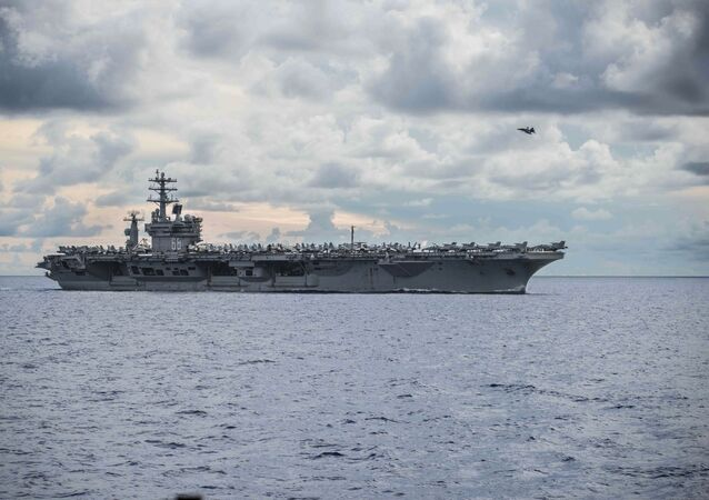 In this photo provided by U.S. Navy, USS Nimitz (CVN 68) steams alongside the Navy's only forward-deployed aircraft carrier USS Ronald Reagan (CVN 76, not in photo) in the South China Sea, Monday, July 6, 2020.