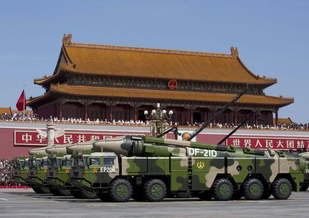 "In this Sept. 3, 2015, file photo, Chinese military vehicles carrying DF-21D anti-ship ballistic missiles, potentially capable of sinking a U.S. Nimitz-class aircraft carrier in a single strike, pass by Tiananmen Gate during a military parade to commemorate the 70th anniversary of the end of World War II, in Beijing. China's military test-fired two missiles into the South China Sea, including a ""carrier killer"" military analysts suggest might have been developed to attack U.S. forces, a newspaper reported Thursday, Aug. 27, 2020."