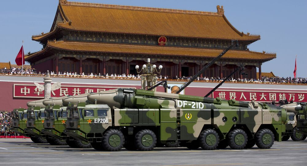 """In this Sept. 3, 2015, file photo, Chinese military vehicles carrying DF-21D anti-ship ballistic missiles, potentially capable of sinking a U.S. Nimitz-class aircraft carrier in a single strike, pass by Tiananmen Gate during a military parade to commemorate the 70th anniversary of the end of World War II, in Beijing. China's military test-fired two missiles into the South China Sea, including a """"carrier killer"""" military analysts suggest might have been developed to attack U.S. forces, a newspaper reported Thursday, Aug. 27, 2020."""