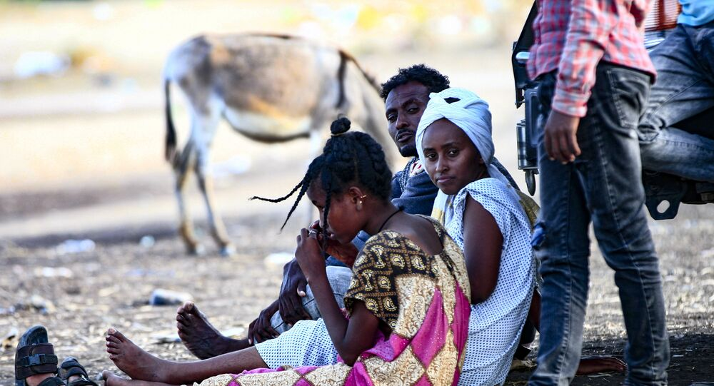 Ethiopian migrants who fled intense fighting in their homeland of Tigray, gather at the border reception centre of Hamdiyet, in the eastern Sudanese state of Kasala, on November 14, 2020.