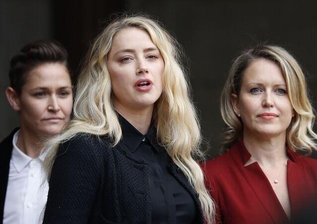 American actress Amber Heard with lawyer Jennifer Robinson