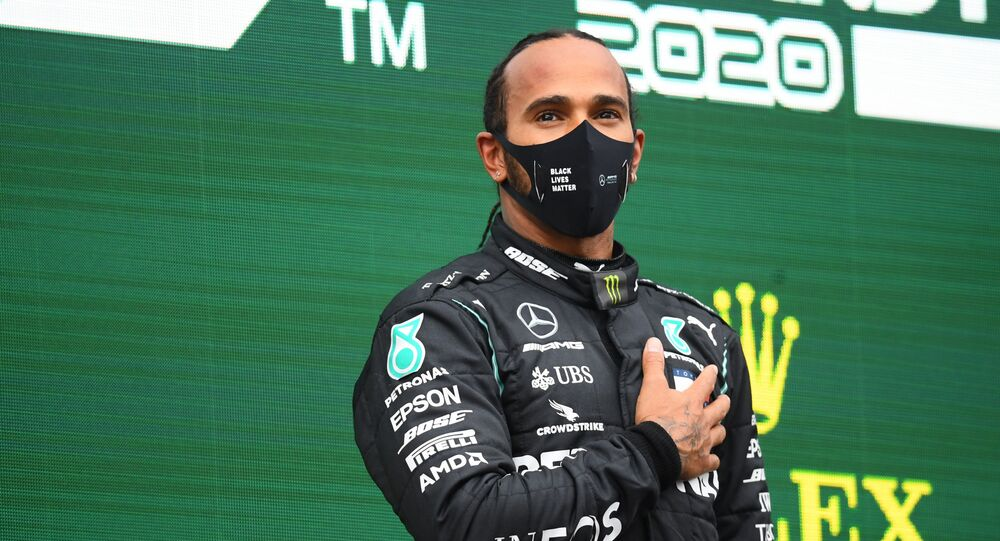 Formula One F1 - Turkish Grand Prix - Istanbul Park, Istanbul, Turkey - November 15, 2020 Mercedes' Lewis Hamilton celebrates on the podium after winning the race and the world championship