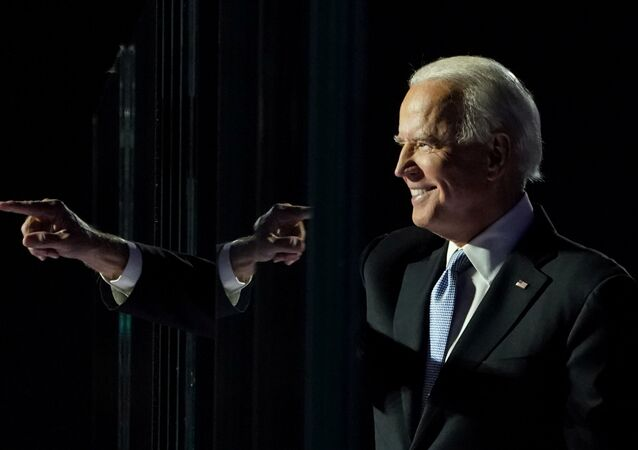 President-elect Joe Biden points a finger at his election rally in Wilmington, Delaware, November 7. REUTERS/Kevin Lamarque