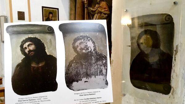 View of the deteriorated version of 'Ecce Homo' mural by 19th century painter Elias Garcia Martinez, right, next to a copy of the original, left, at the Borja Church in Zaragoza, Spain, Wednesday, March 16, 2016. More than three years after a botched fresco restoration by an octogenarian painter became a major tourist attraction for the northern Spanish town of Borja, local officials are looking to inject new life into the phenomenon with the opening Wednesday of a new information center that documents the fresco's success and aims to attract more visitors. - Sputnik International