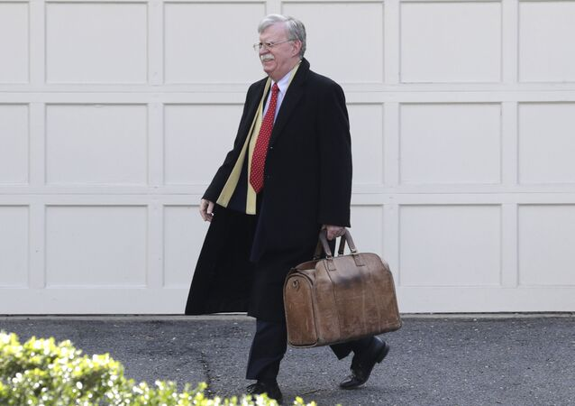 Former National security adviser John Bolton leaves his home in Bethesda, Md. Tuesday, Jan. 28, 2020. President Donald Trump's legal team is raising a broad-based attack on the impeachment case against him even as it mostly brushes past allegations in a new book that could undercut a key defense argument at the Senate trial.