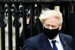Britain's Prime Minister Boris Johnson wearing a face mask leaves the Westminster Abbey following a remembrance service on Armistice Day in London, Britain, November 11, 2020.
