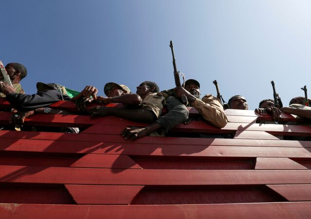 FILE PHOTO: Members of Amhara region militias ride on their truck as they head to the mission to face the Tigray People's Liberation Front (TPLF), in Sanja, Amhara region near a border with Tigray, Ethiopia November 9, 2020