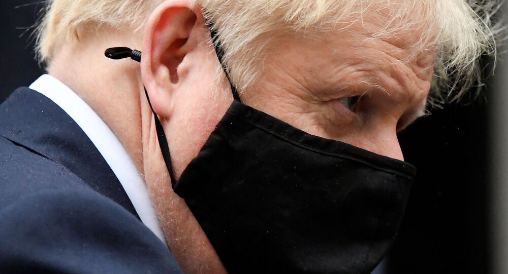 Britain's Prime Minister Boris Johnson, wearing a protective mask, leaves 10 Downing Street in London, Britain October 21, 2020