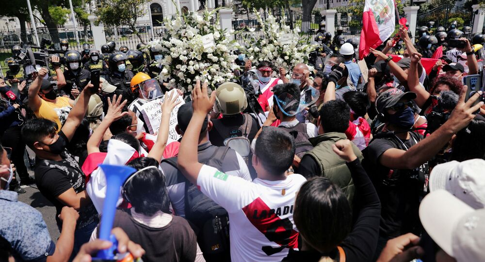 Peruvians are seen outside the Congress building as they celebrate after interim President Manuel Merino resigned in a television address, in Lima, Peru November 15, 2020
