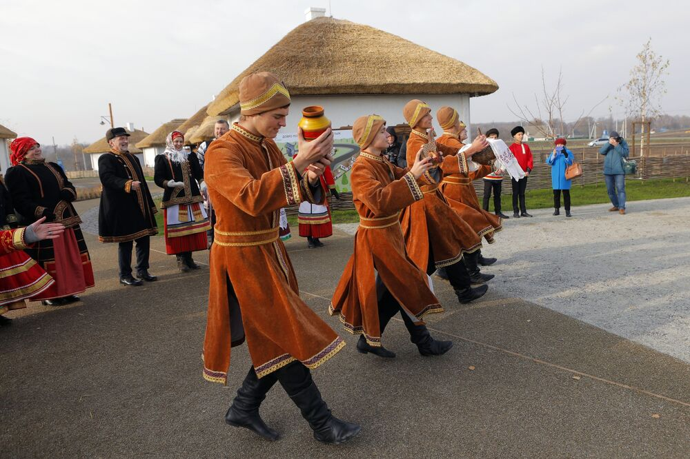 Young men perform during the opening of the Slobozhanschina historical and cultural complex in the Belgorod Region.