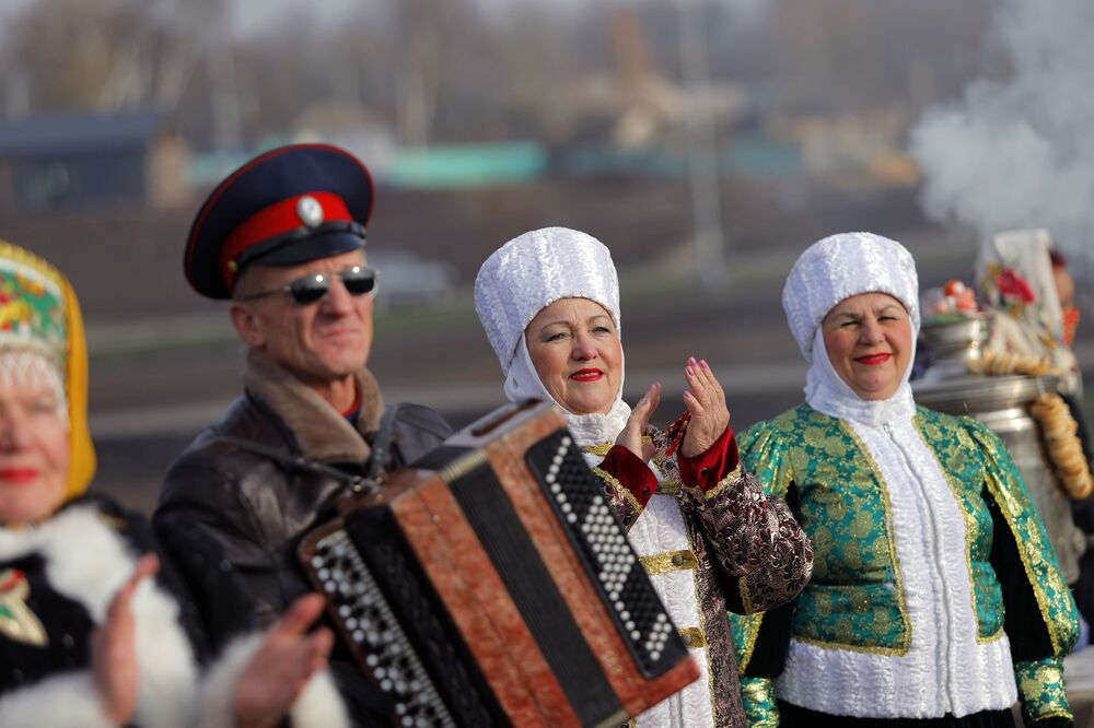 People react during a ceremony marking the opening of the Slobozhanschina historical and cultural complex in the Belgorod Region.