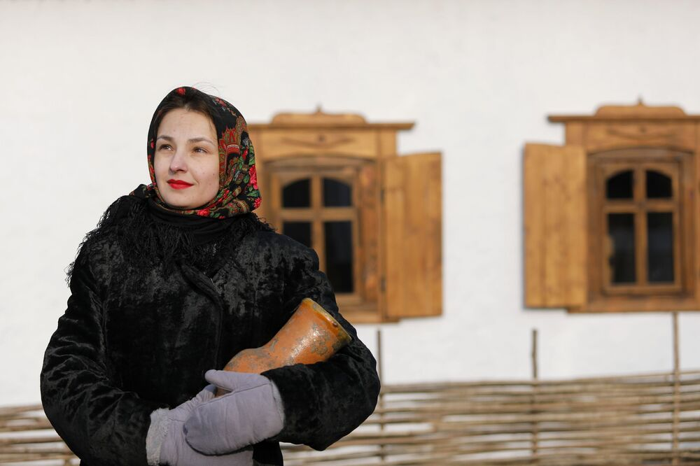 A woman takes part in the opening of the Slobozhanschina historical and cultural complex in the Belgorod Region.
