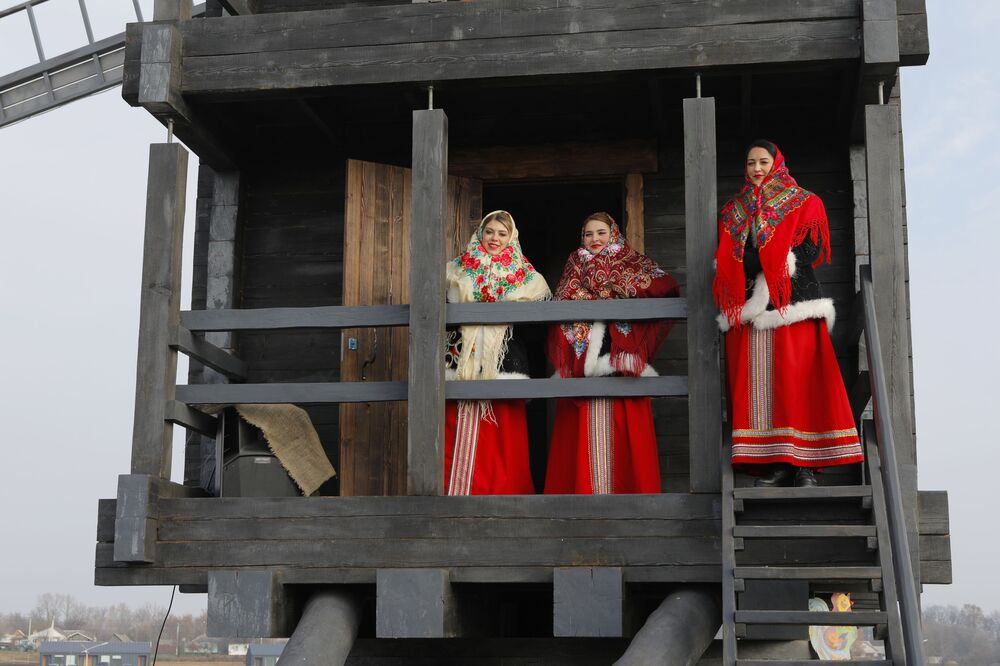 Women dressed in historical costumes take in the opening of the Slobozhanschina historical and cultural complex in the Belgorod Region.