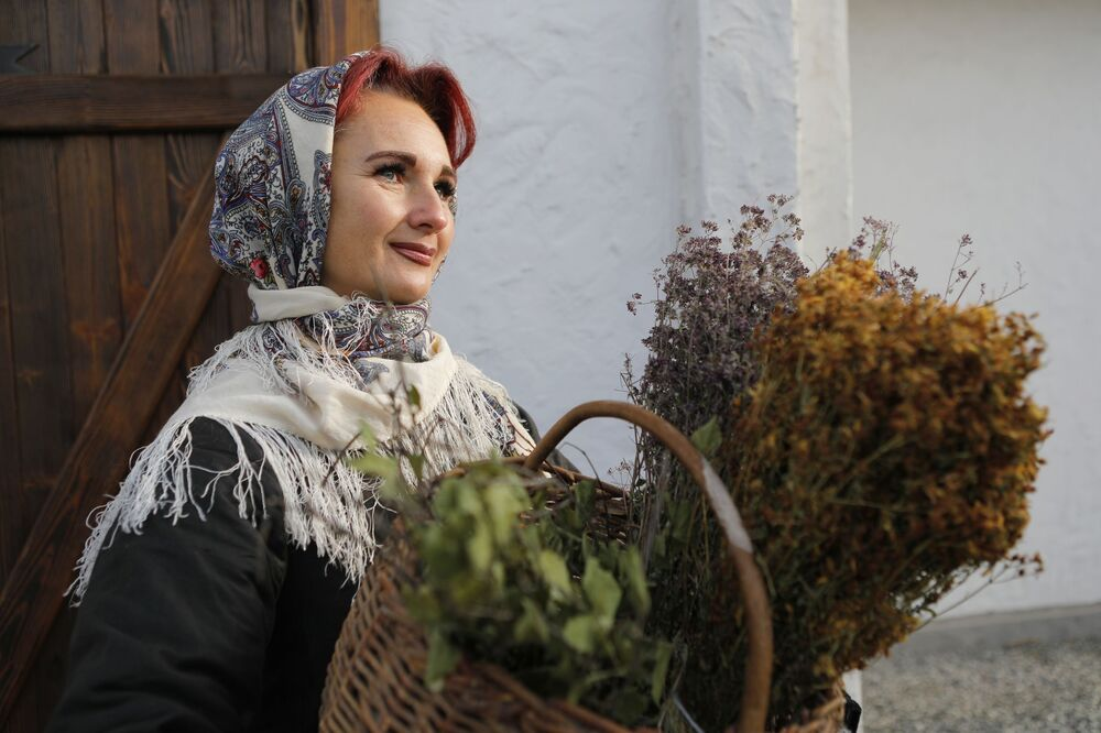 A lady smiles as she takes part in the opening of the Slobozhanschina historical and cultural complex in the Belgorod Region.