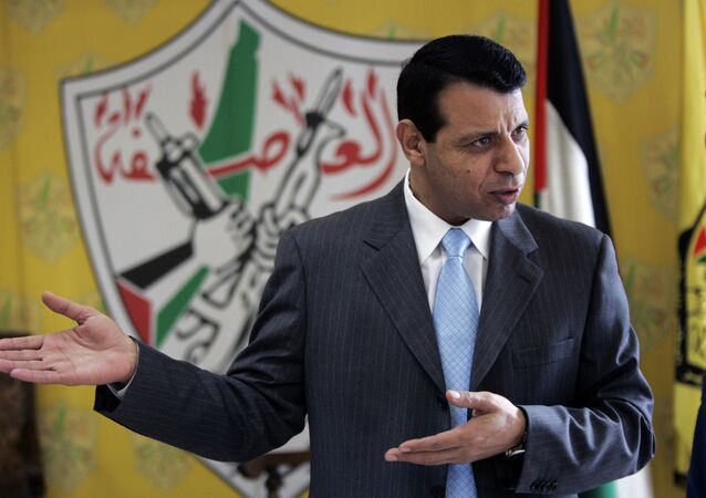 File - In this Jan. 3, 2011 file photo, then Palestinian Fatah leader Mohammed Dahlan gestures as he speaks during an interview with The Associated Press in his office in the West Bank city of Ramallah