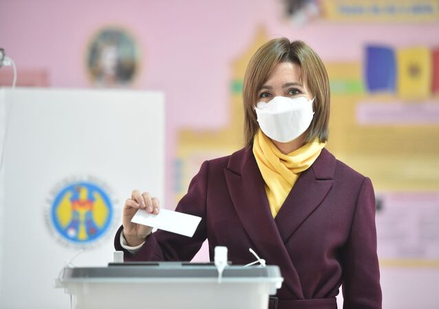 Presidential candidate Maia Sandu wearing a face mask casts her ballot at a polling station during the second round of Moldova's presidential election in Chisinau on November 15, 2020, amid the ongoing coronavirus pandemic.