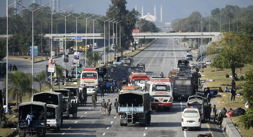 Security forces vehicles are seen along the blocked Islamabad-Rawalpindi highway during an anti-France demonstration by activists and supporters of the Tehreek-e-Labbaik Pakistan (TLP), a religious party, in Islamabad on November 16, 2020. - Pakistan authorities sealed off a major road into the capital Islamabad for a second day on November 16 as a far-right religious party held fresh anti-France protests.