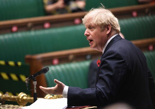 A handout photograph released by the UK Parliament shows Britain's Prime Minister Boris Johnson speaking during the weekly Prime Minister's Questions (PMQs) in the House of Commons in London on November 11, 2020.
