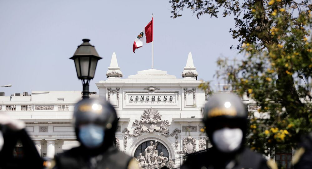 Police stand guard outside the Congress building after Peru's interim President Manuel Merino announced his resignation, in Lima, Peru November 15, 2020.
