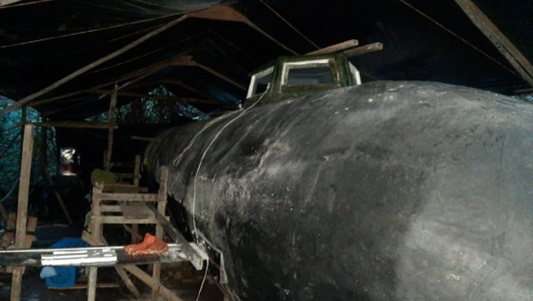 An electric-powered submarine with a cargo capacity of six tons that would have been used for smuggling narcotics out of Colombia. The submarine was found in a boatyard during a raid near the Cucurrupí River in the Chocó area of Colombia on November 5, 2020. - Sputnik International