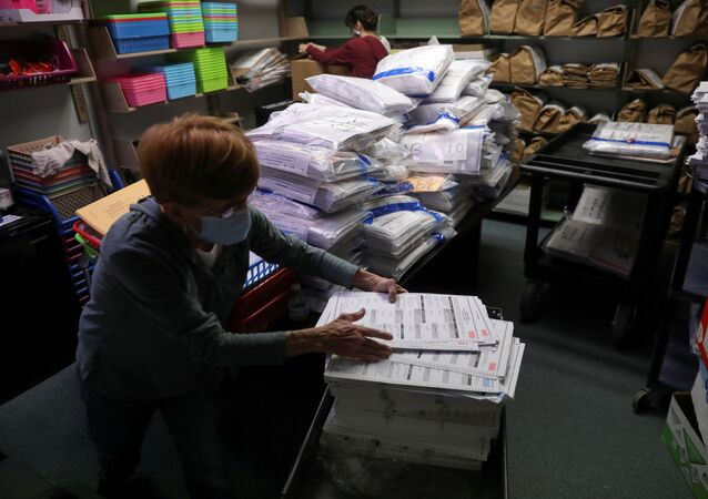 The election official Pam Hainault works in the ballot room organizing unused ballots returned from voting precincts after Election Day at the Kenosha Municipal Building in Kenosha, Wisconsin, U.S. November 4, 2020