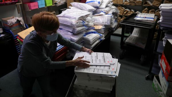The election official Pam Hainault works in the ballot room organizing unused ballots returned from voting precincts after Election Day at the Kenosha Municipal Building in Kenosha, Wisconsin, U.S. November 4, 2020 - Sputnik International