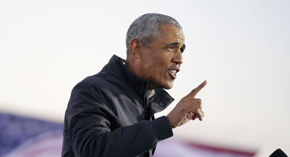 Former President Barack Obama speaks at a rally at Belle Isle Casino in Detroit, Mich., Saturday, Oct. 31, 2020, also attended by Democratic presidential candidate former Vice President Joe Biden