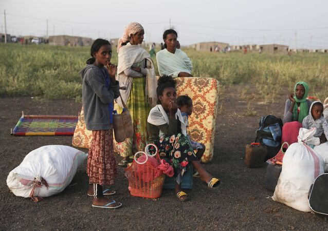 Refugees gather in Qadarif region, eastern Sudan, having fled the war in Ethiopia's Tigray region.