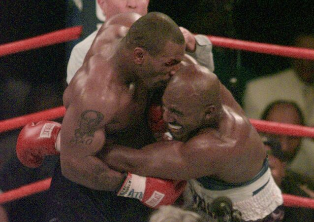 FILE -- Mike Tyson bites into the ear of Evander Holyfield in the third round of their WBA Heavyweight match Saturday, June 28, 1997, at the MGM Grand in Las Vegas