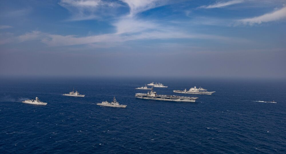 This handout photo taken and released by the Indian Navy on November 17, 2020 shows a ships taking part in the second phase of the Malabar naval exercise in the Arabian sea. - India, Australia, Japan and the United States started the second phase of a strategic navy drill on November 17 in the Northern Arabian sea.