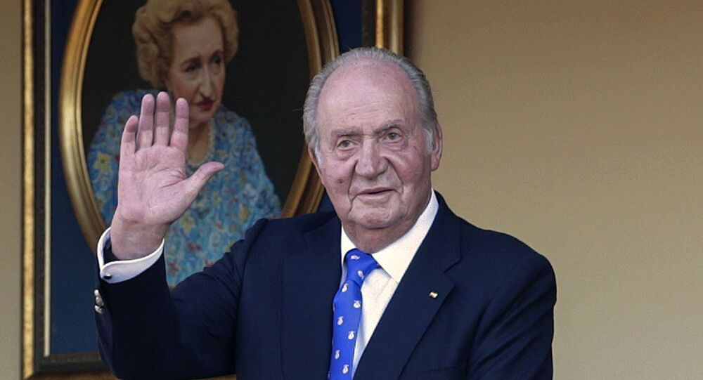 In this Sunday, June 2, 2019 file photo, Spain's former King Juan Carlos waves during a bullfight at the bullring in Aranjuez, Madrid, Spain. Spain's royal household said on Monday Aug. 17, 2020, that former monarch Juan Carlos is in the United Arab Emirates, resolving a mystery over his whereabouts that has swirled in Spain since he announced he was leaving the country amid a growing financial scandal.