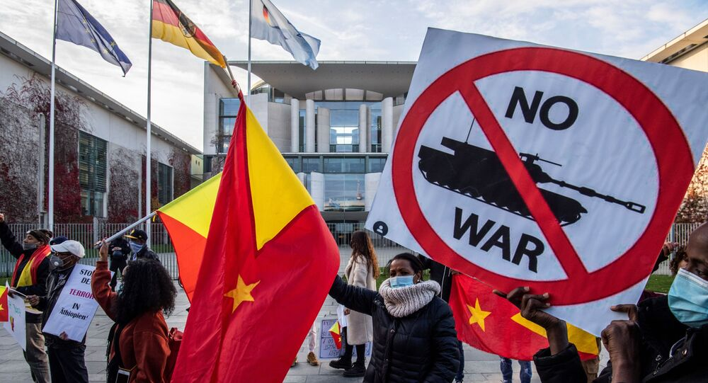 Pro-Tigrayan demonstrators display placards during a protest in front of the Chancellery in Berlin on November 12, 2020, over a week-old conflict in northern Ethiopia between the regional ruling party, the Tigray People's Liberation Front (TPLF), and the government of Prime Minister Abiy Ahmed.