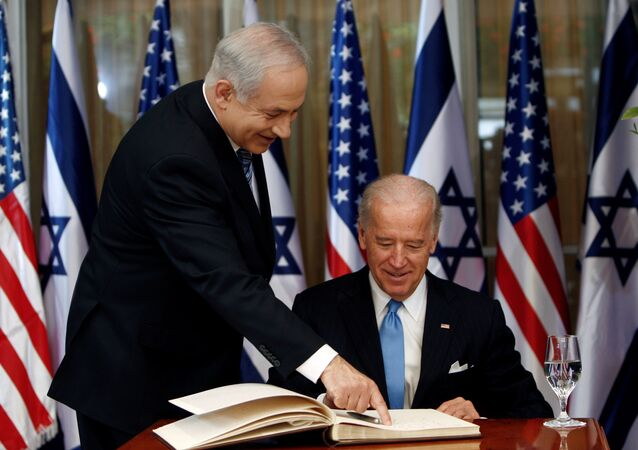 U.S. Vice President Biden prepares to sign the guest book at Netanyahu's residence in Jerusalem