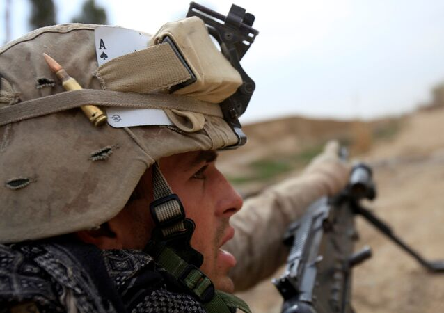 A U.S. Marine from Bravo Company of the 1st Battalion, 6th Marines gestures during an operation in Marjah, Helmand province February 21, 2010. NATO forces are facing strong resistance eight days into a major offensive in southern Afghanistan as Taliban fighters dig in to fight to the death.
