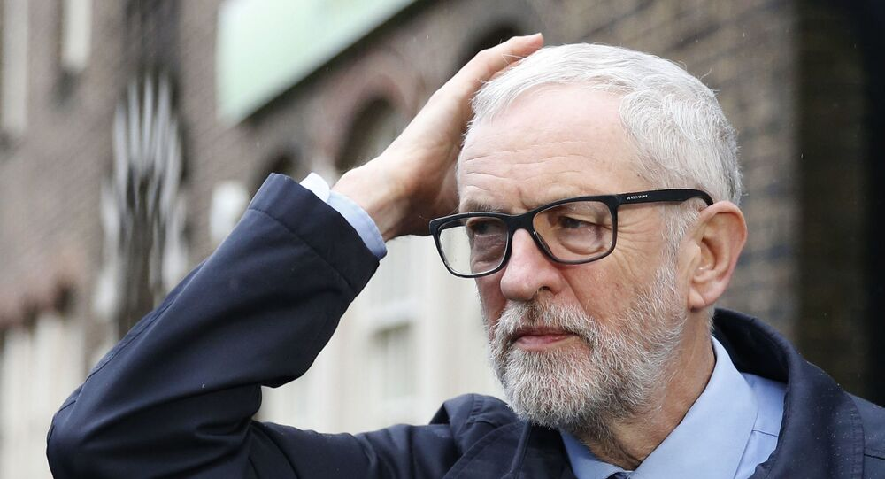 Britain's Labour party leader Jeremy Corbyn leaves after a press conference on the coronavirus, outside the Finsbury Park Jobcentre, in north London,  Sunday, March 15, 2020.