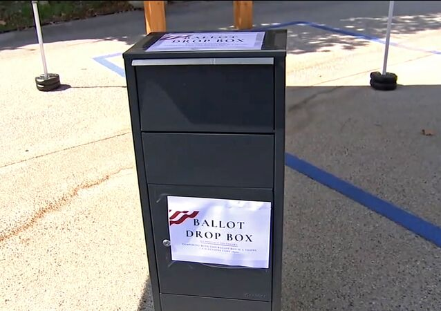 This photo from video provided by ABC7 Los Angeles shows an unofficial ballot drop box at Grace Baptist Church in Santa Clarita, Calif., in October, 2020. California's ballot harvesting law is creating controversy this election year. The law allows for people to collect ballots from voters and return them to county election offices. Republicans have set up unofficial drop boxes in some counties with closely contested U.S. House races. State officials say the boxes are illegal and have ordered the party to remove them. But party leaders say they are using the boxes to collect ballots as the law allows. At least one Democratic campaign has designated volunteers who receive ballots at their homes from voters who want help in returning them.