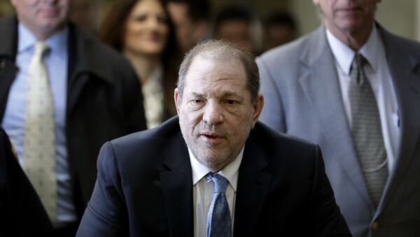 In this Feb. 24, 2020, file photo, Harvey Weinstein arrives at a Manhattan courthouse as jury deliberations continue in his rape trial in New York. The disgraced Hollywood film mogul and convicted rapist is asking a bankruptcy judge in Delaware to allow him to pursue arbitration in New York over what he claims is his wrongful termination from the company he co-founded. - Sputnik International