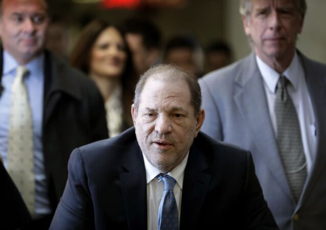 In this Feb. 24, 2020, file photo, Harvey Weinstein arrives at a Manhattan courthouse as jury deliberations continue in his rape trial in New York. The disgraced Hollywood film mogul and convicted rapist is asking a bankruptcy judge in Delaware to allow him to pursue arbitration in New York over what he claims is his wrongful termination from the company he co-founded.