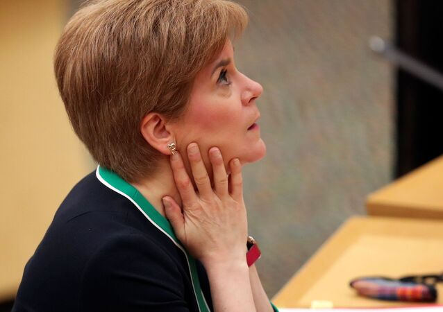 Scottish First Minister Nicola Sturgeon looks on during a statement to the Scottish Parliament on the coronavirus disease (COVID-19) restrictions, in Edinburgh, Scotland, Britain November 17, 2020