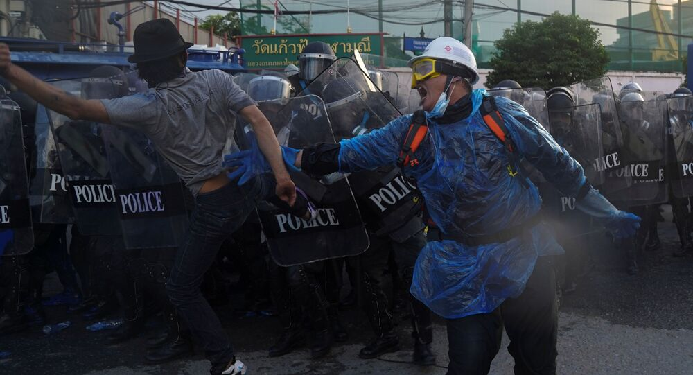 Demonstrators clash with riot police during an anti-government protest as lawmakers debate  constitution change, outside the parliament in Bangkok, Thailand, 17 November 2020.