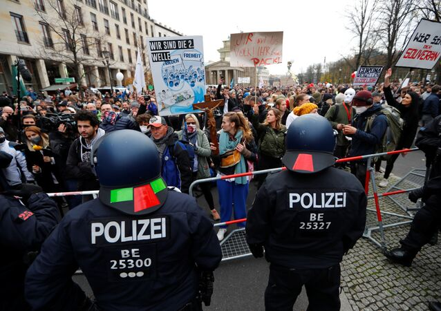 Demonstrators attend a protest against the government's coronavirus disease (COVID-19) restrictions, near the Reichstag, the seat of Germany's lower house of parliament Bundestag, in Berlin, November, 18, 2020