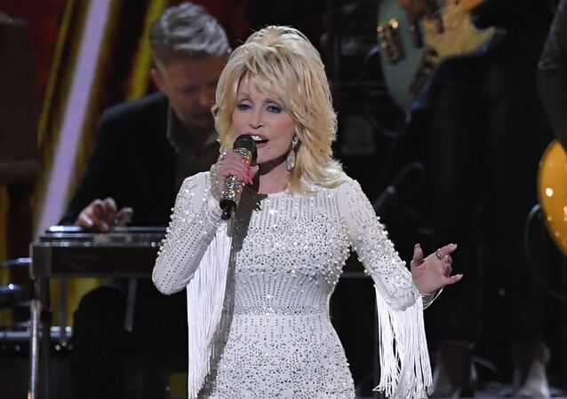 FILE - This Nov. 13, 2019 file photo shows Dolly Parton performing at the 53rd annual CMA Awards in Nashville, Tenn.