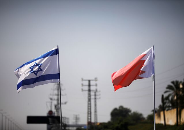 The flags of Israel and Bahrain flutter along a road in Netanya, Israel 14 September 2020.